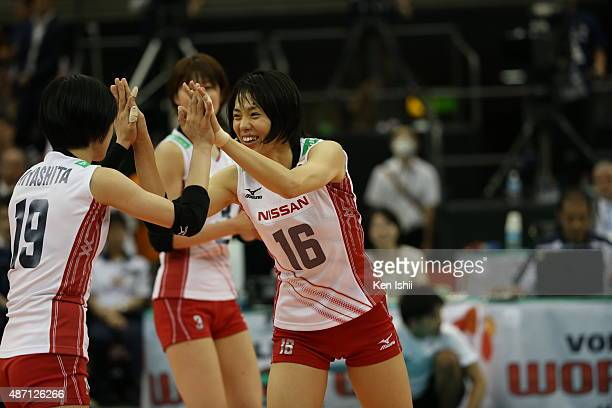 Saori Sakoda of Japan celebrates with her teammate after a point in the match between Japan and China during the FIVB Women's Volleyball World Cup...