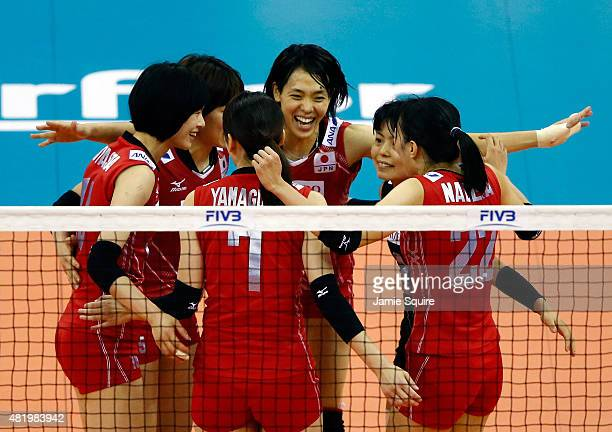 Saori Sakoda of Japan celebrates with teammates after a point during the final round match against Italy on day 4 of the FIVB Volleyball World Grand...