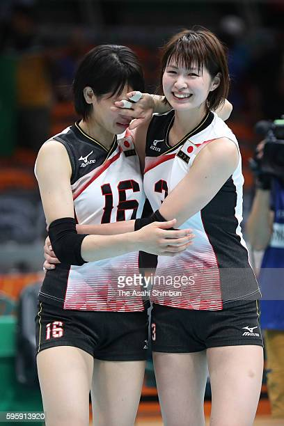 Saori Sakoda of Japan is consoled by Saori Kimura after the Women's Quarterfinal match between Japan and The United States on day 11 of the Rio 2106...