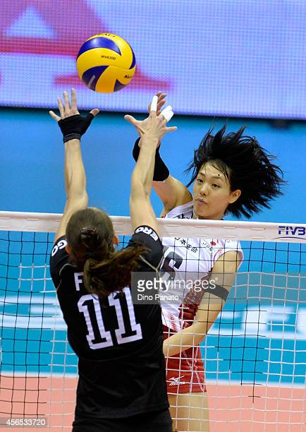 Saori Sakoda of Japan spikes the ball against to Christiane Frst during the FIVB Women's World Championship pool E match between Germany and Japan on...