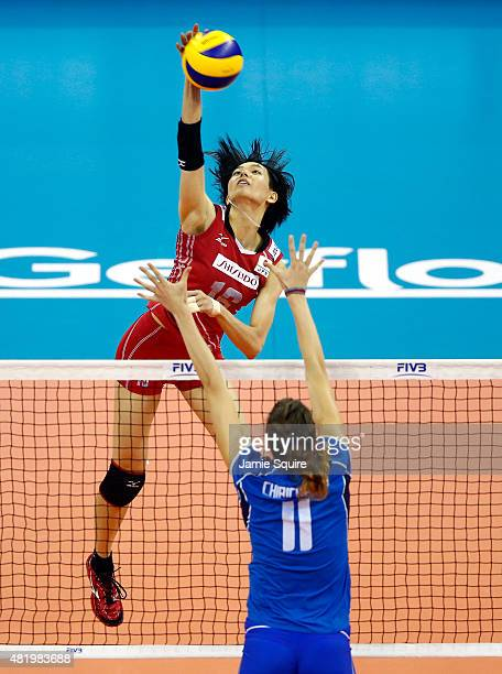 Saori Sakoda of Japan spikes the ball as Cristina Chirichella of Italy blocks during the final round match on day 4 of the FIVB Volleyball World...