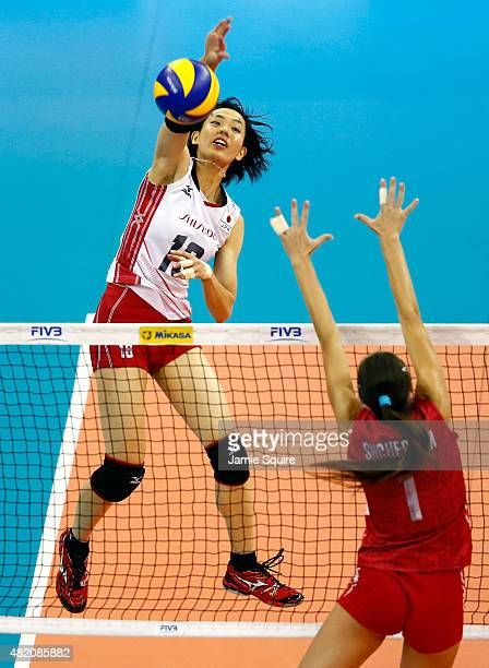 Saori Sakoda of Japan spikes the ball as Ekaterina Lyubushkina of Russia defends during the final round match on day 5 the FIVB Volleyball World...