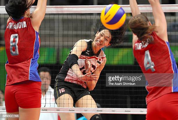 Saori Sakoda of Japan spikes the ball during the Women's preliminary volleyball match between Japan and Russia on Day 7 of the Rio 2016 Olympic Games...