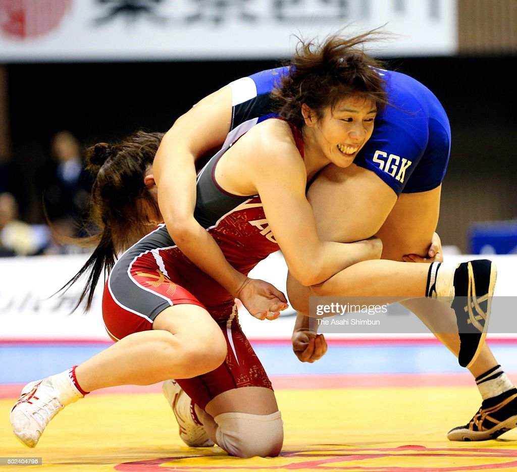 <a gi-track='captionPersonalityLinkClicked' href=/galleries/search?phrase=Saori+Yoshida&family=editorial&specificpeople=2374710 ng-click='$event.stopPropagation()'>Saori Yoshida</a> (red) and Hikari Sugawara (blue) compete in the Women's -55kg final during day three of the All Japan Wrestling Championships at Yoyogi National Gymnasium on December 23, 2015 in Tokyo, Japan.