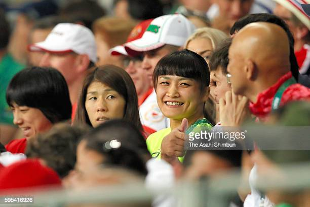 Saori Yoshida and Kaori Icho of Japan are seen in the stand as Ismael Borrero Molina of Cuba competes against Shinobu Ota of Japan in the during the...