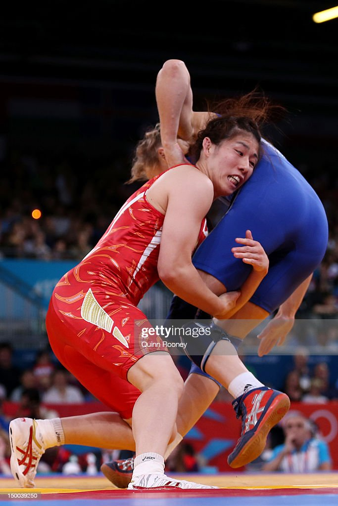 <a gi-track='captionPersonalityLinkClicked' href=/galleries/search?phrase=Saori+Yoshida&family=editorial&specificpeople=2374710 ng-click='$event.stopPropagation()'>Saori Yoshida</a> of Japan (red) and <a gi-track='captionPersonalityLinkClicked' href=/galleries/search?phrase=Yuliya+Ratkevich&family=editorial&specificpeople=6331800 ng-click='$event.stopPropagation()'>Yuliya Ratkevich</a> of Azerbaijan compete in the Women's Freestyle 55 kg Wrestling on Day 13 of the London 2012 Olympic Games at ExCeL on August 9, 2012 in London, England.