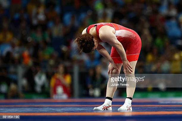 Saori Yoshida of Japan reacts after being defeated by Helen Louise Maroulis of the United States during the Women's Freestyle 53 kg Gold medal match...
