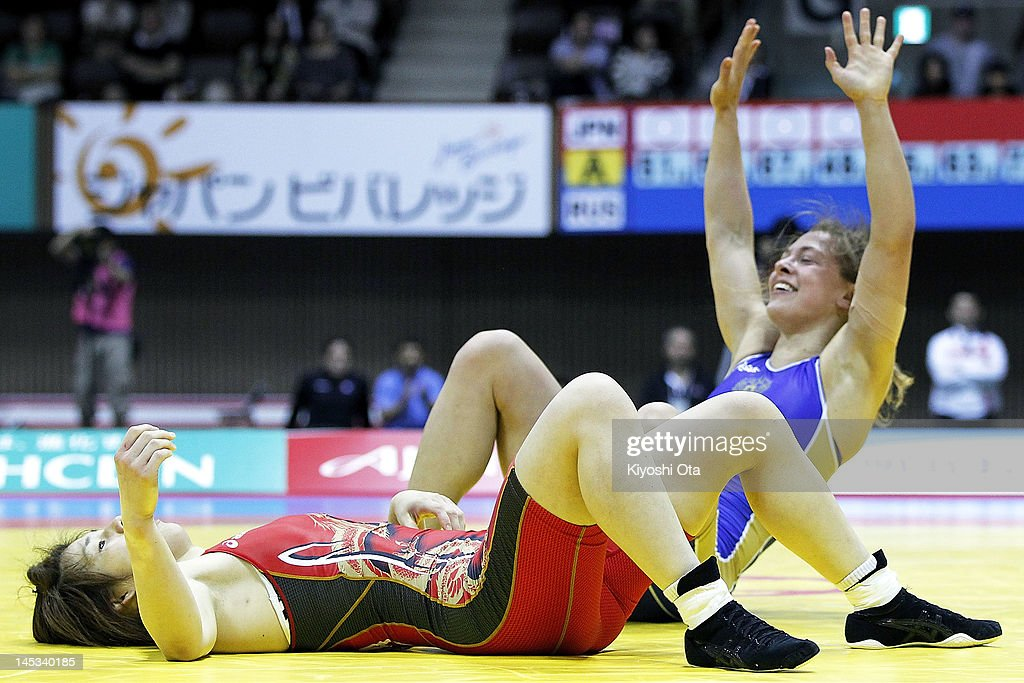 <a gi-track='captionPersonalityLinkClicked' href=/galleries/search?phrase=Saori+Yoshida&family=editorial&specificpeople=2374710 ng-click='$event.stopPropagation()'>Saori Yoshida</a> (L) of Japan reacts as she loses the 55kg division of the final match against Vareria Zholobova of Russia during day two of the 2012 Female Wrestling World Cup at Yoyogi National Gymnasium on May 27, 2012 in Tokyo, Japan.