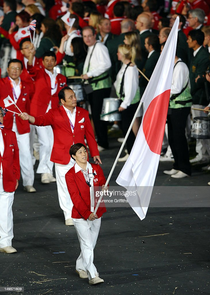 <a gi-track='captionPersonalityLinkClicked' href=/galleries/search?phrase=Saori+Yoshida&family=editorial&specificpeople=2374710 ng-click='$event.stopPropagation()'>Saori Yoshida</a> of the Japan Olympic wrestling team carries her country's flag during the Opening Ceremony of the London 2012 Olympic Games at the Olympic Stadium on July 27, 2012 in London, England.