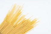 some dried spaghetti pasta on a white surface