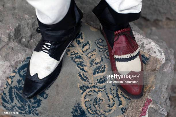 Sapeur from the group belonging to Papa Griffe shows off different shoes on February 13 2016 in Kinshasa DRC The word Sapeur comes from SAPE a French...