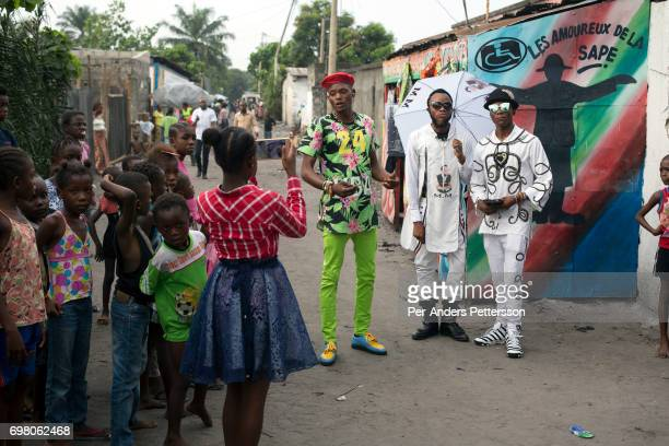 Sapeur group in the streets on February 12 2017 in Kinshasa DRC The word Sapeur comes from SAPE a French acronym for Sociéé des Ambianceurs et...