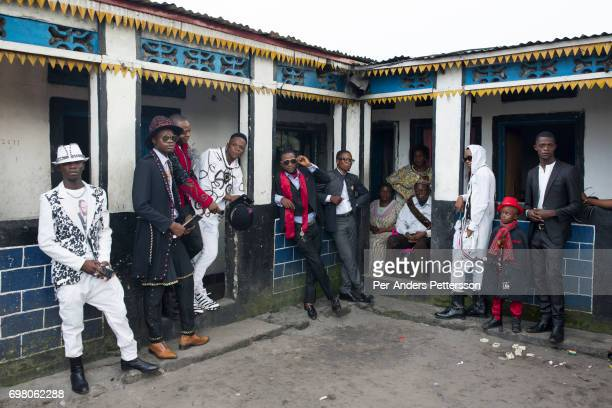 Sapeur group poses for pictures at a family house on February 12 2017 in Kinshasa DRC The word Sapeur comes from SAPE a French acronym for Sociéé des...