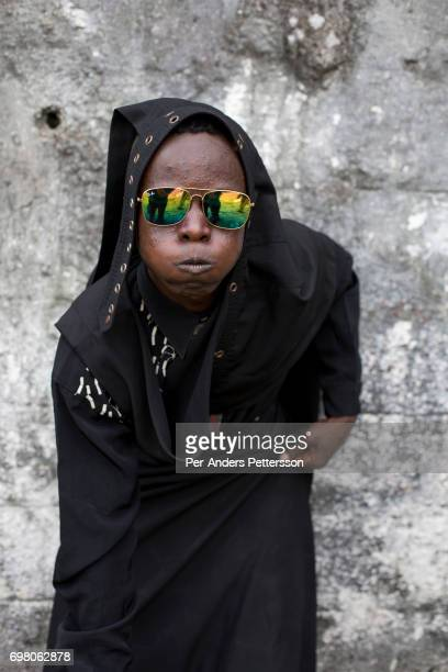 Sapeur poses for a portrait with his designer label clothes while paying his respects to Stervos Nyarcos the founder of the kitendi religion which...