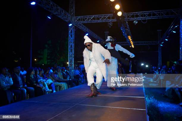 Sapeurs led by Papa Griffe walks on the catwalk at Kinshasa Fashion Week on July 18 at Shark club in Kinshasa DRC Local and invited foreignbased...