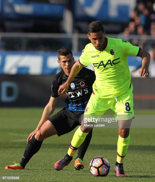 Saphir Sliti Taider of Bologna FC is challenged by Remo Freuler of Atalanta BC during the Serie A match between Atalanta BC and Bologna FC at Stadio...