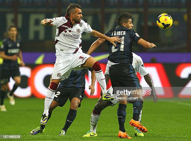Saphir Sliti Taider of FC Internazionale Milano competes for the ball with Giuseppe Gemiti of AS Livorno Calcio during the Serie A match between FC...