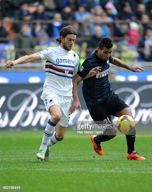 Saphir Sliti Taider of FC Internazionale Milano competes for the ball against Andrea Costa of UC Sampdoriaduring the Serie A match between FC...