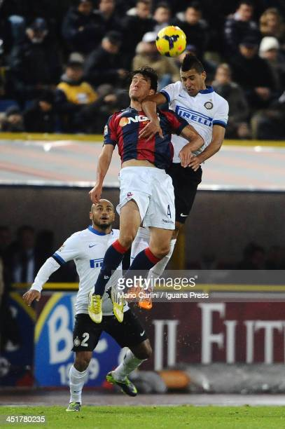 Saphir Taider Internazionale Milano wins a header over Renè Khrin of Bologna FC during the Serie A match between Bologna FC and FC Internazionale...