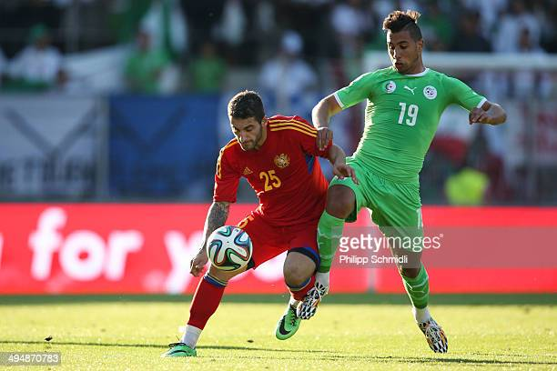 Saphir Taider of Algeria fights for the ball with Norair Aslanyan of Armenia during the international friendly match between Algeria and Armenia at...