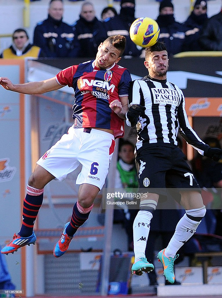 Saphir Taider of Bologna and Alessio Sestu of Siena in action during the Serie A match between Bologna FC and AC Siena at Stadio Renato Dall'Ara on February 10, 2013 in Bologna, Italy.