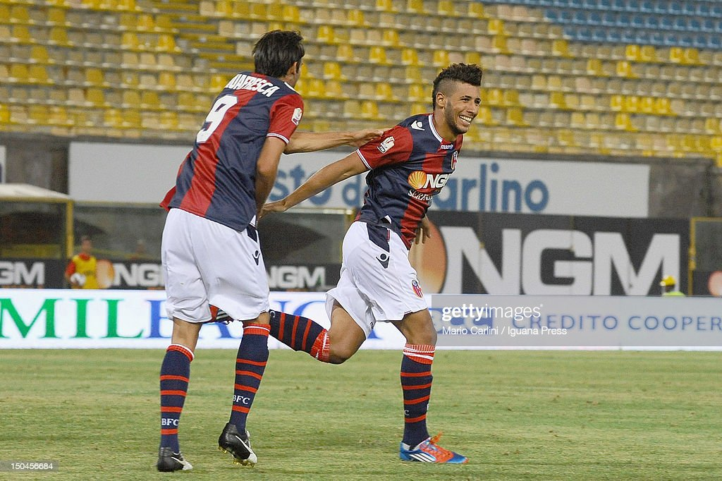 Saphir Taider # 6 of Bologna FC (L) celebrates with his teamates after scoring his team's opening goal during the TIM Cup match between Bologna FC and AS Varese at Stadio Renato Dall'Ara on August 18, 2012 in Bologna, Italy.