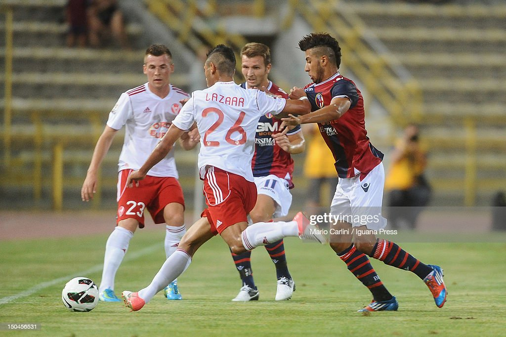 Saphir Taider # 6 of Bologna FC (R) competes the ball with Achraf Lazaar # 26 of AS Varese (L) during the TIM Cup match between Bologna FC and AS Varese at Stadio Renato Dall'Ara on August 18, 2012 in Bologna, Italy.