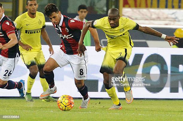 Saphir Taider of Bologna FC competes the ball with Geoffrey Kondogbia of Internazionale Milano during the Serie A match between Bologna FC and FC...
