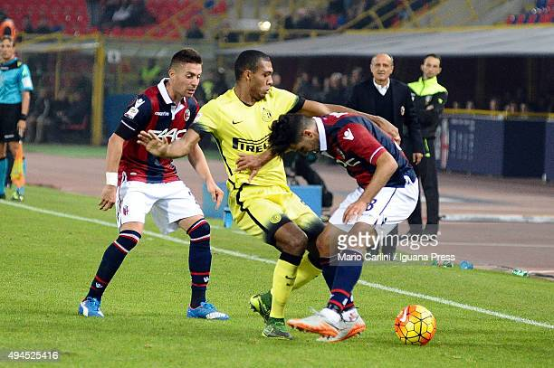 Saphir Taider of Bologna FC competes the ball with Juan Jesus of Internazionale Milano during the Serie A match between Bologna FC and FC...