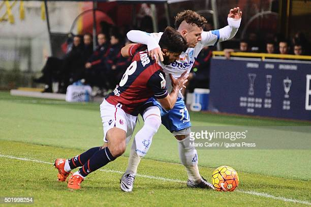 Saphir Taider of Bologna FC competes the ball with Marcel Buchel of Empoli FC during the Serie A match between Bologna FC and Empoli FC at Stadio...