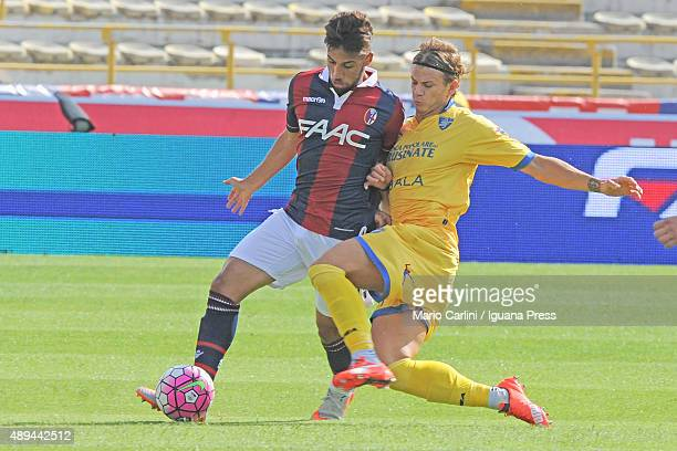 Saphir Taider of Bologna FC competes the ball with Samuele Longo of Frosinone Calcio during the Serie A match between Bologna FC and Frosinone Calcio...