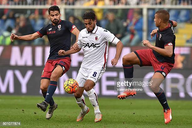 Saphir Taider of Bologna FC is challenged by Sebastien De Maio and Tomas Rincon of Genoa CFC during the Serie A match betweeen Genoa CFC v Bologna FC...