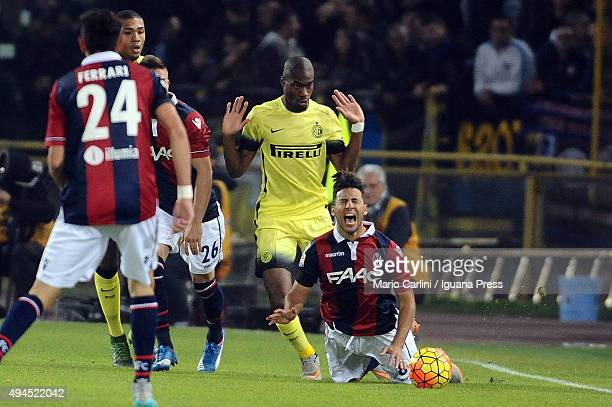 Saphir Taider of Bologna FC is tackled during the Serie A match between Bologna FC and FC Internazionale Milano at Stadio Renato Dall'Ara on October...