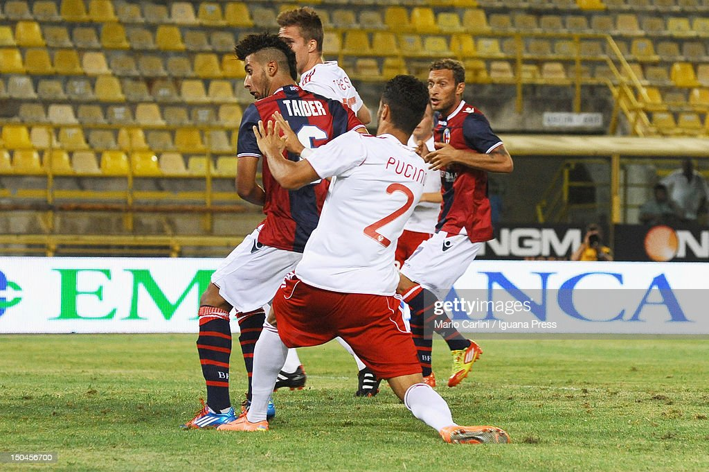 Saphir Taider # 6 of Bologna FC (L) scores his team's opening goal during thw TIM Cup match between Bologna FC and AS Varese at Stadio Renato Dall'Ara on August 18, 2012 in Bologna, Italy.