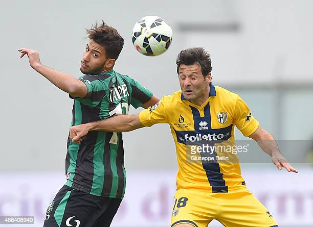 Saphir Taider of Sassuolo and Massimo Gobbi of Parma in action the Serie A match between US Sassuolo Calcio and Parma FC at Mapei Stadium on March 15...