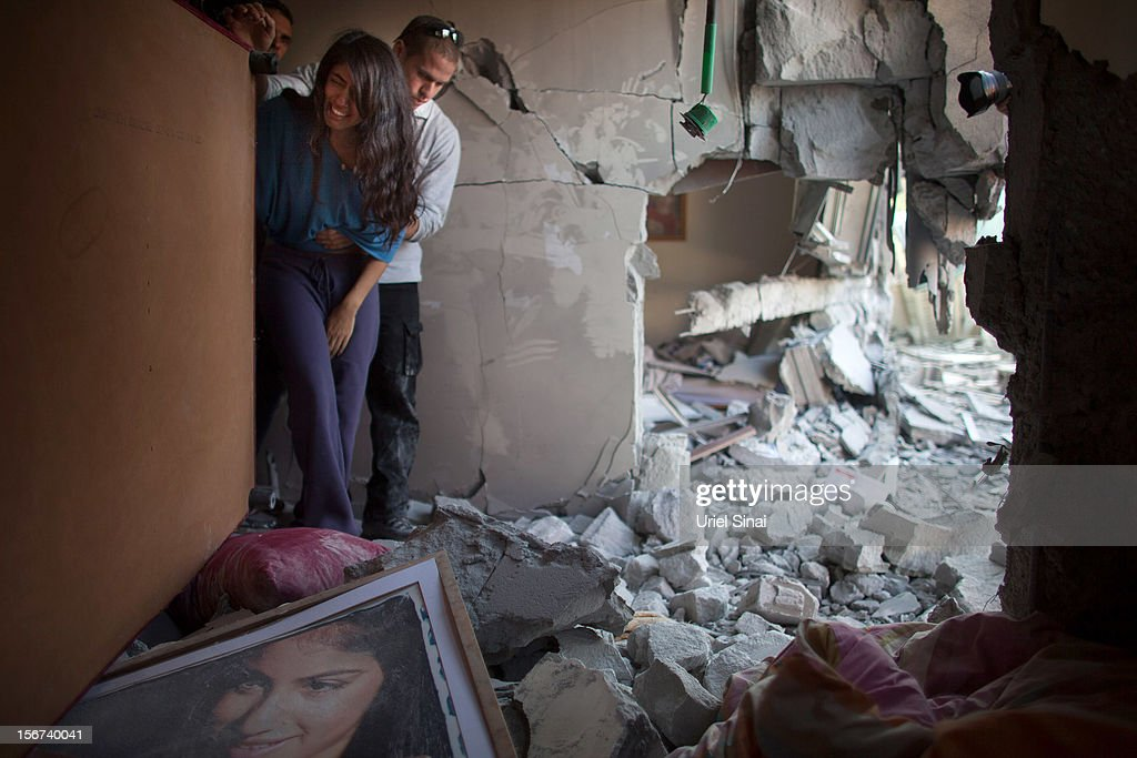 Sapir Hachmon and her boyfriend Ron Vachnish react as they enter her room after it was hit by a rocket fired from the Gaza Strip on November 20, 2012 in Beersheba, Israel. Hamas militants and Israel are continuing talks aimed at a ceasefire as the death toll in Gaza reaches over 100 with three Israelis also having been killed by rockets fired by Palestinian militants.