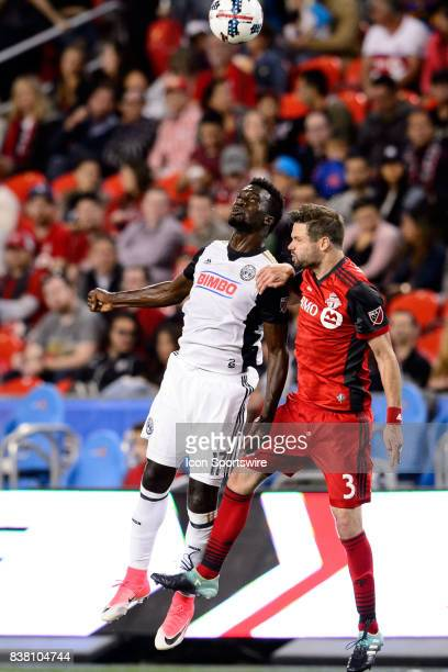C J Sapong of Philadelphia Union and Drew Moor of Toronto FC jump for the ball during the second half of the MLS Soccer regular season game between...