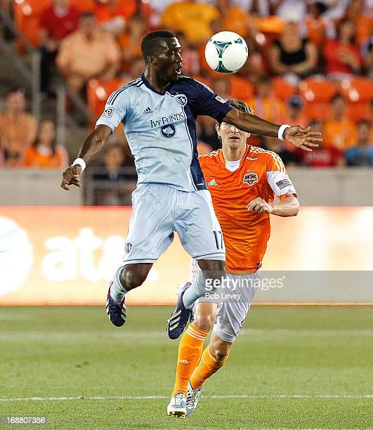 J Sapong of Sporting KC chests the ball down inftont of Bobby Boswell of Houston Dynamo at BBVA Compass Stadium on May 12 2013 in Houston Texas