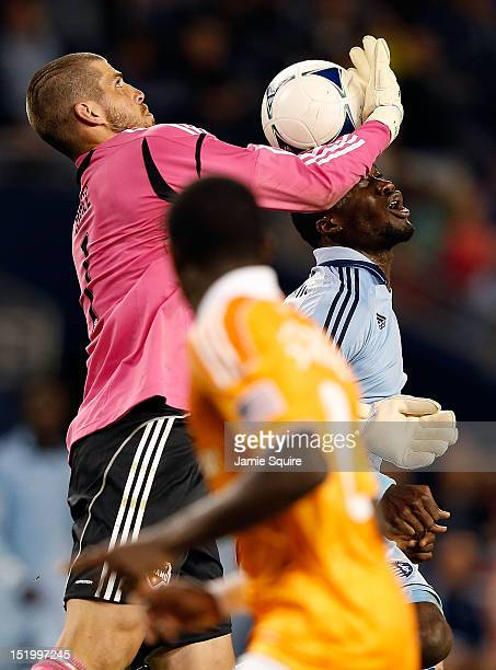 J Sapong of Sporting KC tires to score as goalkeeper Tally Hall of Houston Dynamo defends during the MLS game at Livestrong Sporting Park on...