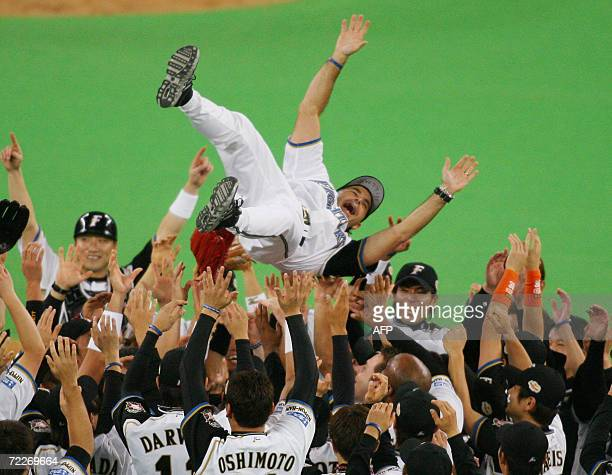Pacific League champion Nippon Ham Fighters manager Trey Hillman is tossed up in the air by players after they won the Japan Series baseball in...