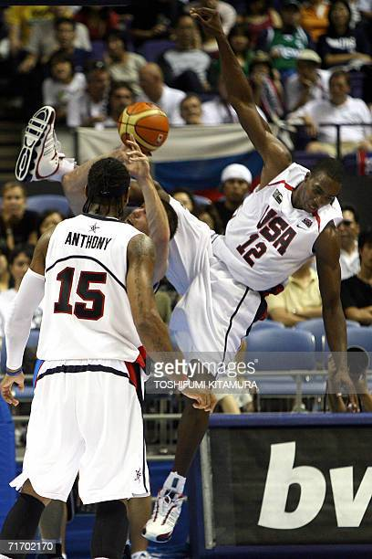 US Dwight Howard is collides with Italy's Richard Mason Rocca as Carmelo Anthony looks on during their Group D preliminary round match against Italy...