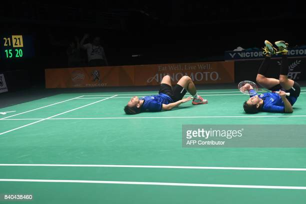 Sapsiree Taerattanachai and Dechapol Puavaranukroh of Thailand celebrate their victory against Goh Soon Huat and Shevon Jemie Lai of Malaysia during...