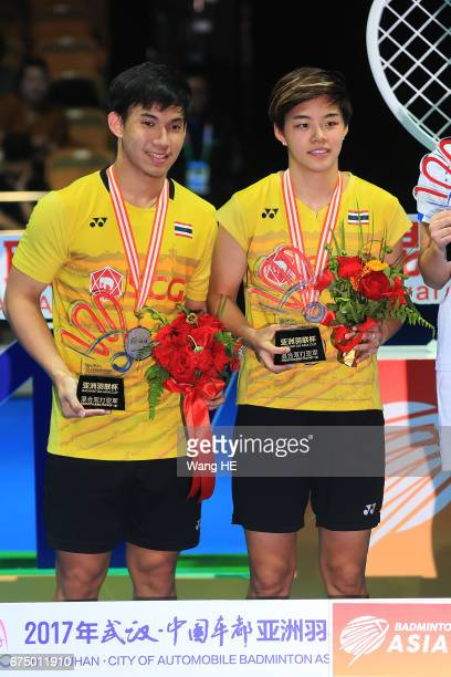 Sapslewiree Taerattan and Dechapol Puavaranukrohof Thailand with their silver medal on the podium after losing their mixed doubles final match...