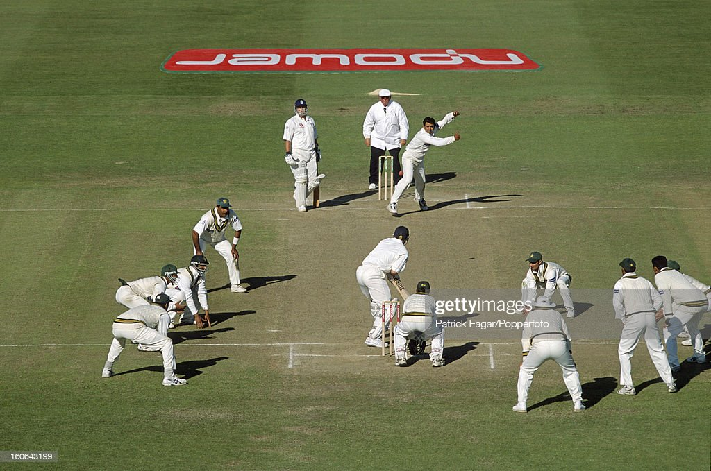 Saqlain Mushtaq bowls to Matthew Hoggard. All eleven Pakistan team members are in the photograph, 2nd Test England v Pakistan Old Trafford May, June 2001