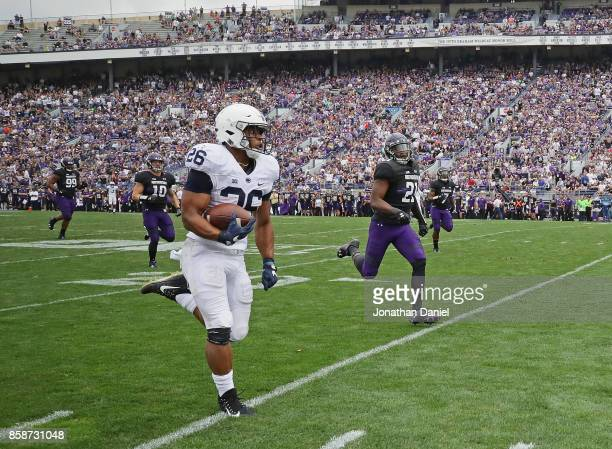 Saquon Barkley of the Penn State Nittany Lions breaks a 53 yard touchdown run against the Northwestern Wildcats at Ryan Field on October 7 2017 in...