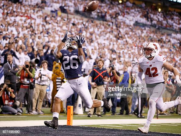 Saquon Barkley of the Penn State Nittany Lions catches a touchdown pass in the fourth quarter of the Big Ten Championship game against the Wisconsin...