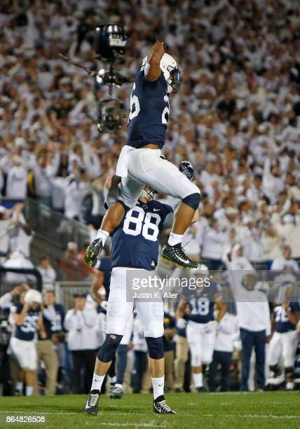 Saquon Barkley of the Penn State Nittany Lions celebrates after catching a 42 yard touchdown pass in the second half against the Michigan Wolverines...
