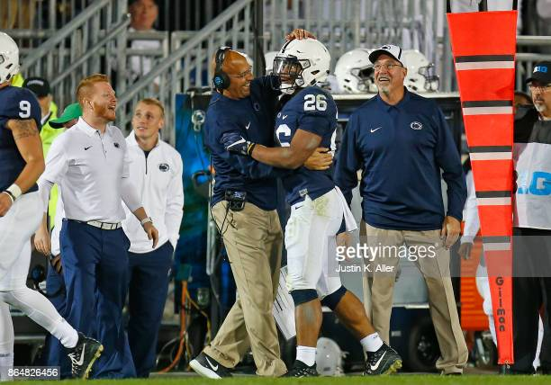 Saquon Barkley of the Penn State Nittany Lions celebrates with head coach James Franklin of the Penn State Nittany Lions after catching a 42 yard...