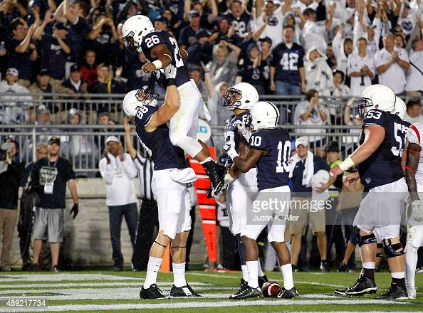 Saquon Barkley of the Penn State Nittany Lions celebrates with Mike Gesicki after rushing for a 15yard touchdown in the second quarter during the...
