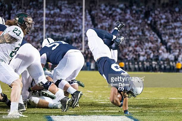 Saquon Barkley of the Penn State Nittany Lions flips into the end zone for a touchdown during the second quarter against the Michigan State Spartans...